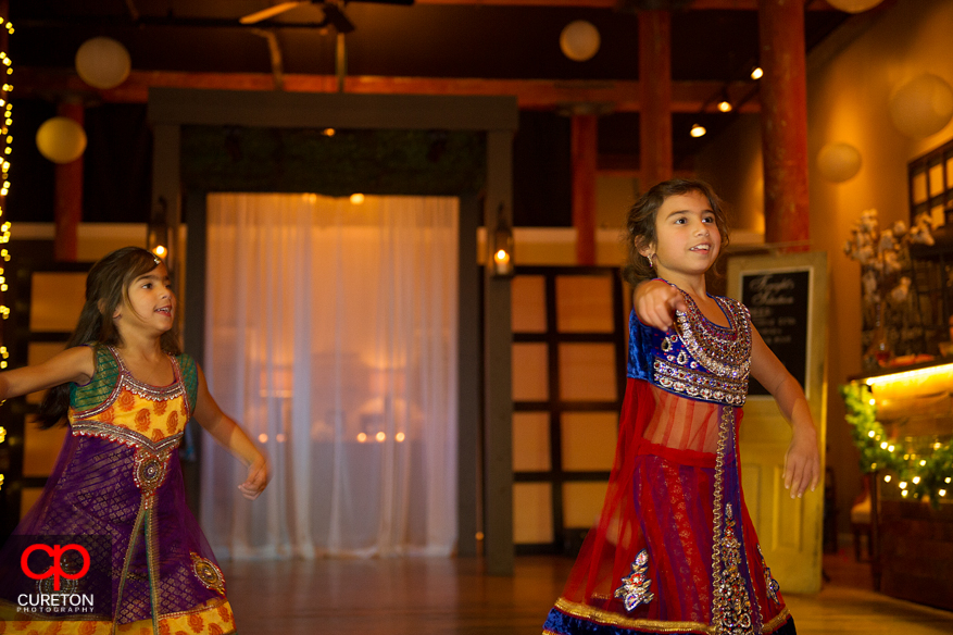 Flower girl dancing a traditional Indian dance at the reception.