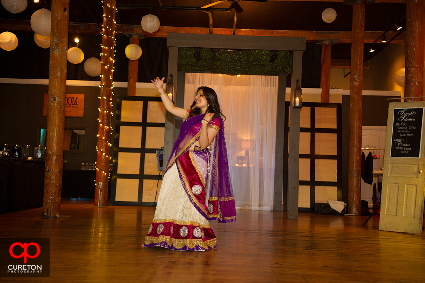 Bride's cousin dances for her at the reception.