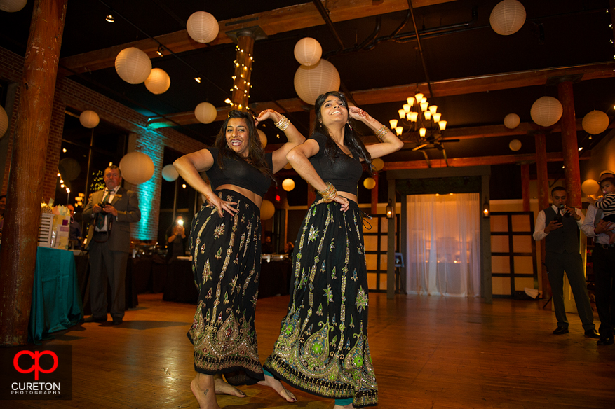 Bride's sister performs for her at her Indian wedding reception.