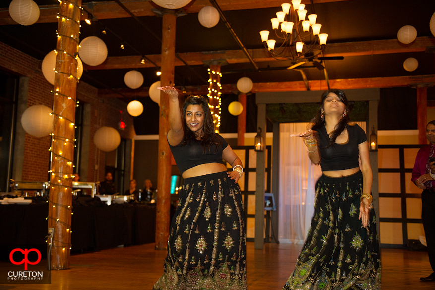 Bride's sister dances and performs for her at her Indian wedding reception at The Loom.