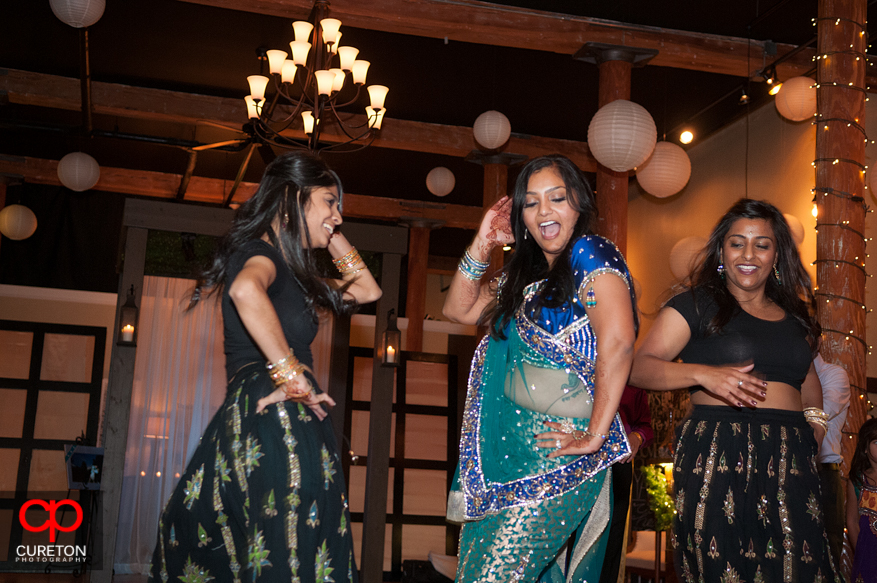 Bride dances with her sister after her performance at the reception.