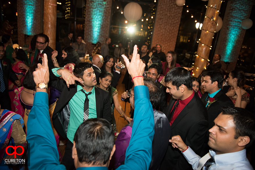Bride's family dancing at her wedding reception.