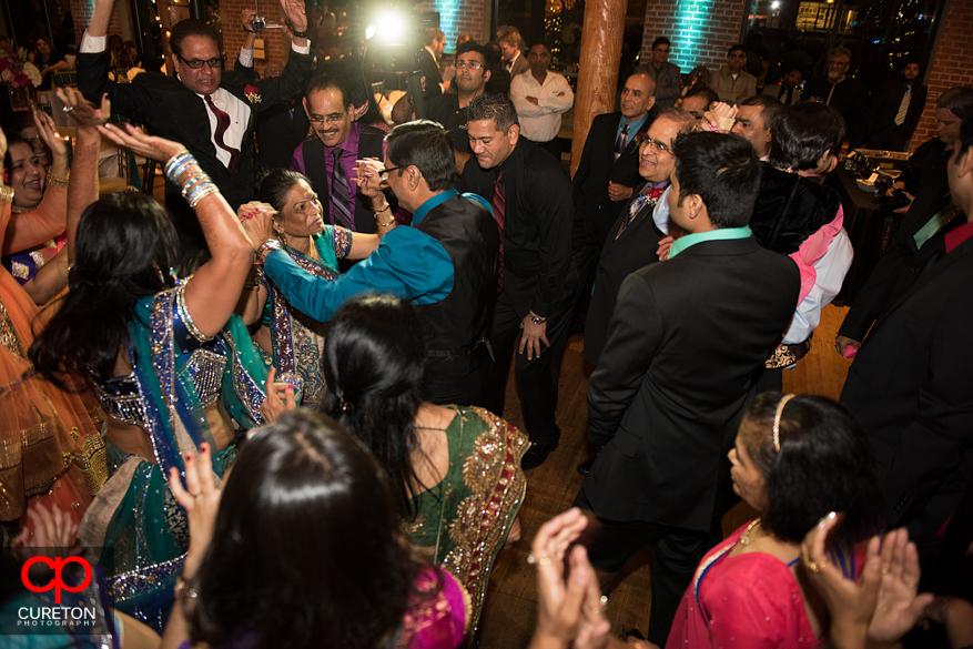 Bride's parents dancing at her Indian wedding reception.