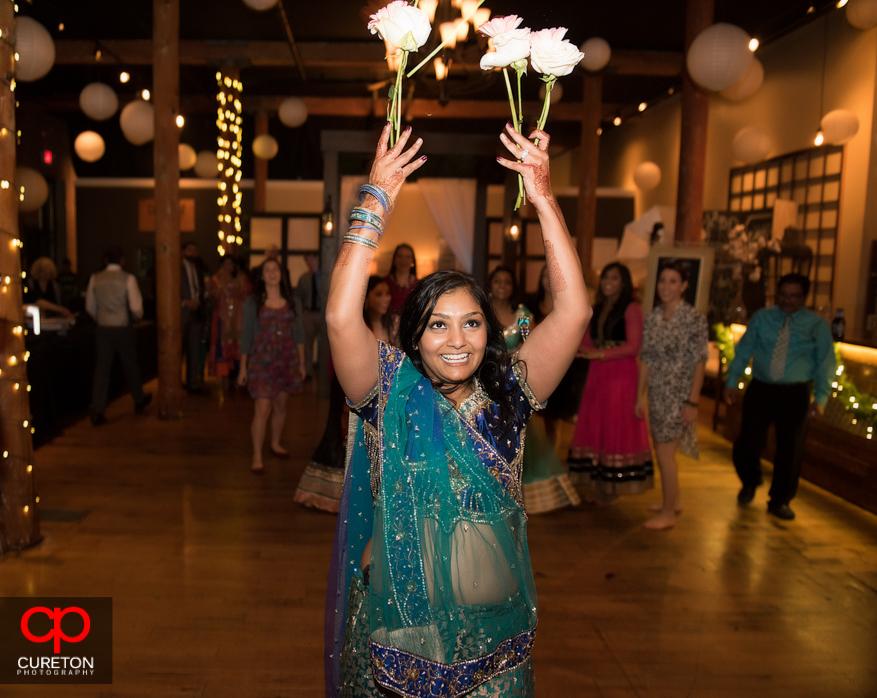 Bride throwing flowers instead of bouquet .