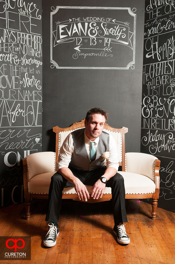 Groom poses at the Photo Booth.