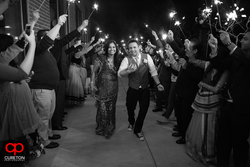 Bride and Groom making a sparkler exit at The Loom in Simpsonville.