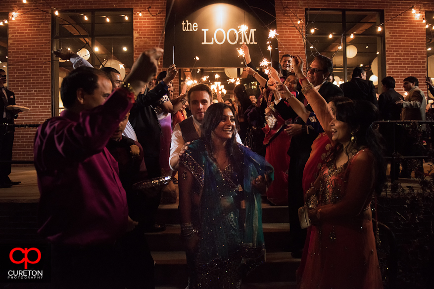 Bride an Groom during a sparkler leave at The Loom in Simpsonville after their Indian wedding reception.