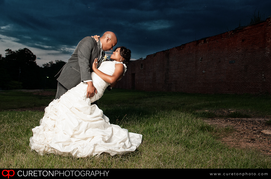 Groom and Bride doing the dip outside of The Loom in Simpsonville,SC.