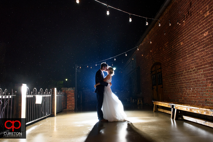 Epic photo of bride and groom after their Old Cigar Warehouse wedding reception in downtown Greenville,SC.