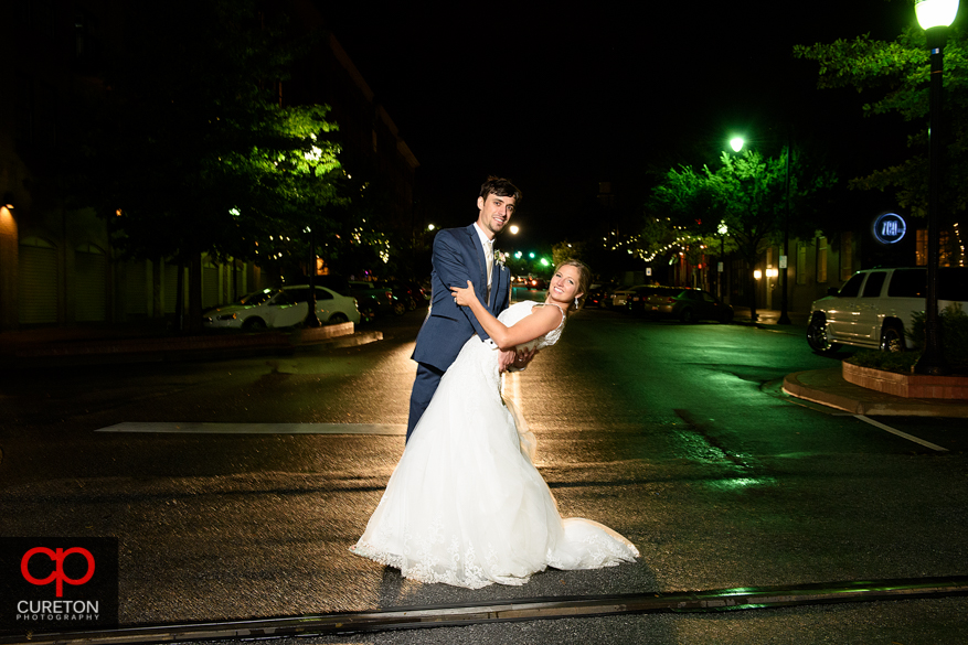 Bride and groom dancing on Main St. downtown Greenville,SC.