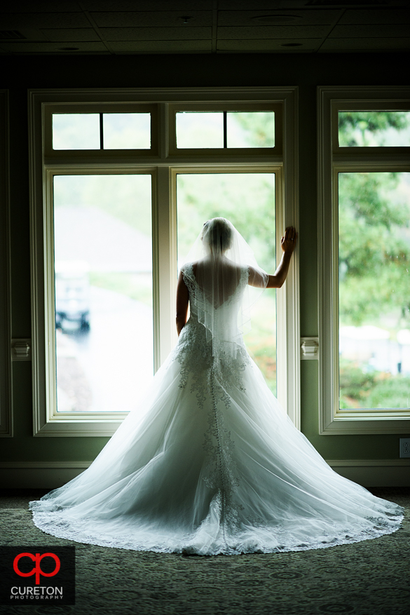 Bride looking out the window at Cliffs Glassy clubhouse.