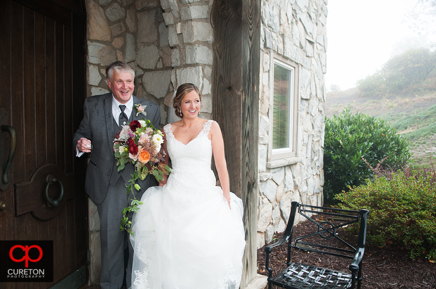 Bride and father waiting to enter the chapel.
