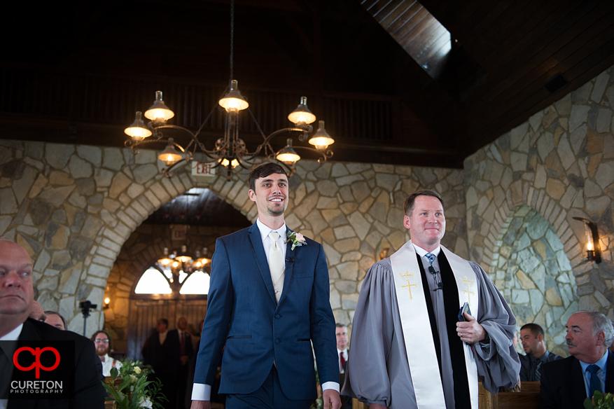 Groom walks down the aisle during their Glassy Chapel wedding..