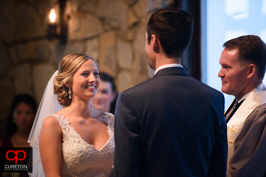 Bride looks at groom during their Glassy Chapel wedding.