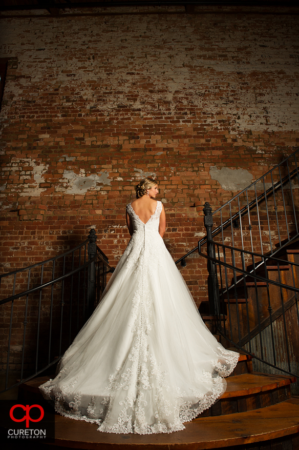 Beautiful Bride standing on the staircase at OCW.