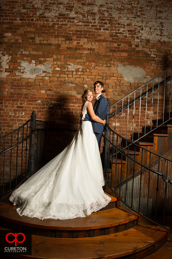 Bride and Groom on the staircase at the Old Cigar Warehouse.