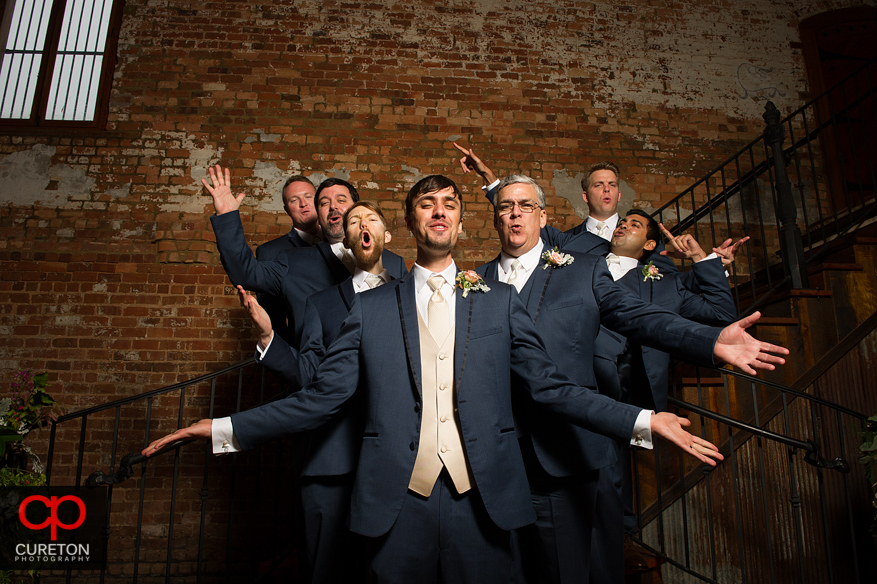 The groomsmen on the stairs at the Old Cigar Warehouse.