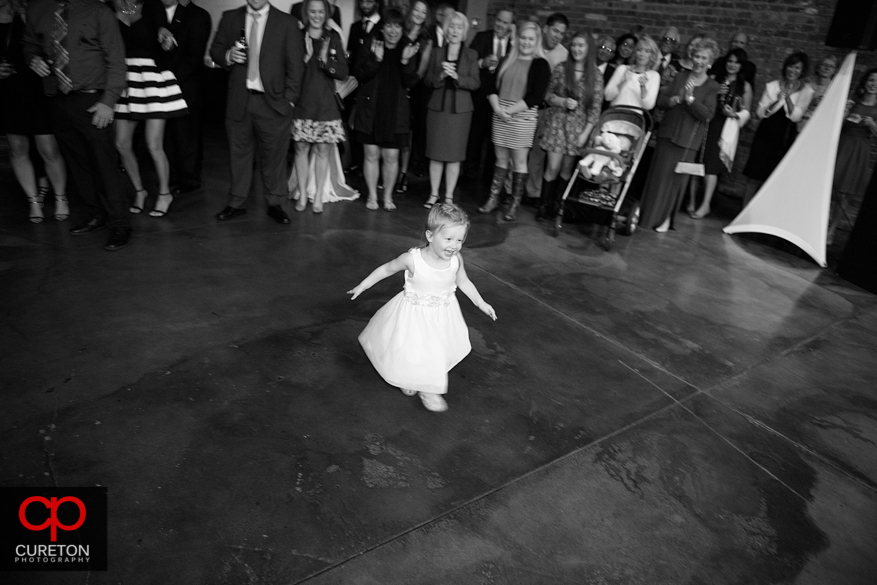 Child dancing at the reception.