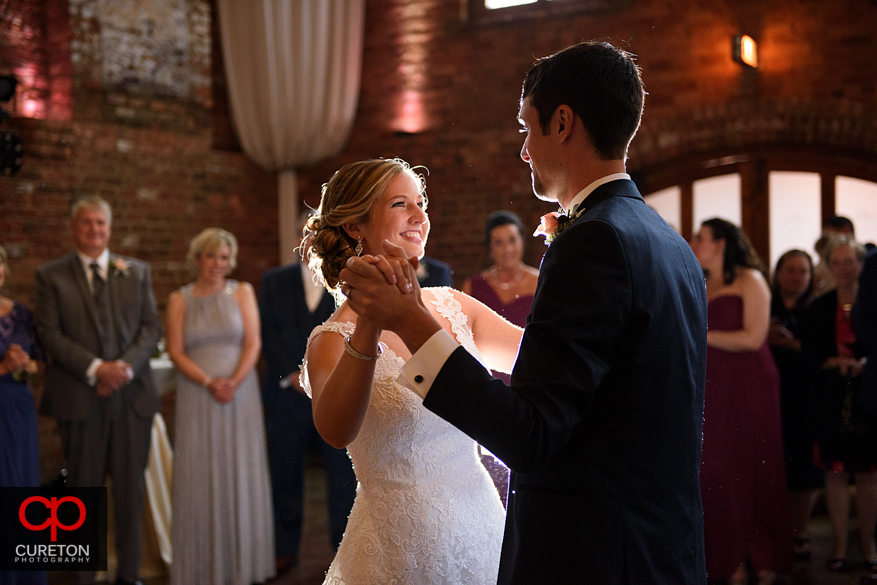 Bride and groom have a first dance at the Old Cigar Warehouse.