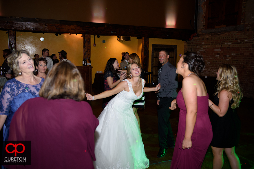 Wedding guests dancing the Old Cigar Warehouse.