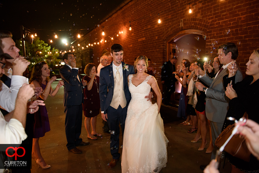 Wedding leave through bubbles at the Old Cigar Warehouse.