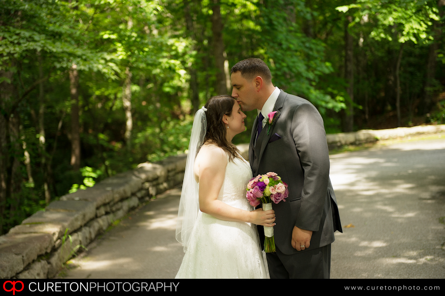 Bride and groom share a moment outside Table Rock lodge.