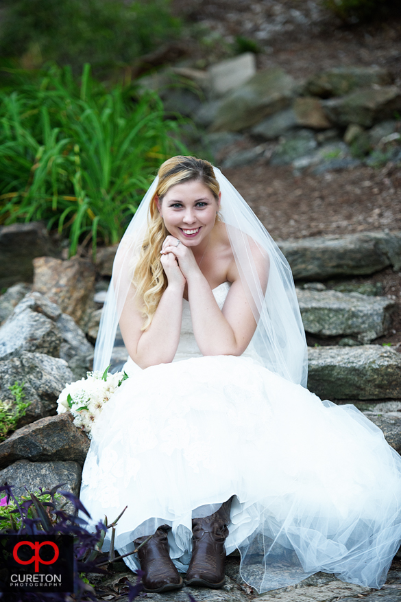 Bride on the steps of the rock quarry garden.