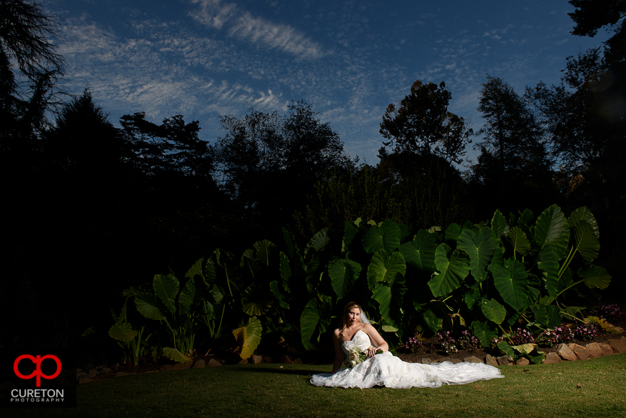 Bride on the ground during a Rock Quarry Garden bridal in downtown Greenville,SC.