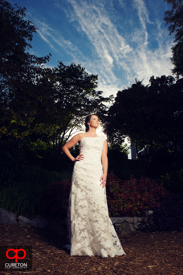 Bride with pretty sky at The Rock Quarry Garden.