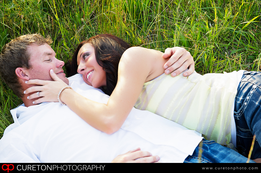 A couple at a rustic engagement shoot.