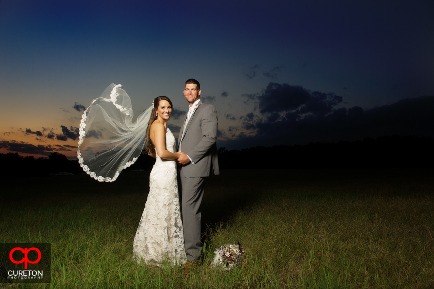 Bride and Groom with veil blown in the wind.