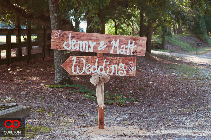 Sign pointing to the wedding.