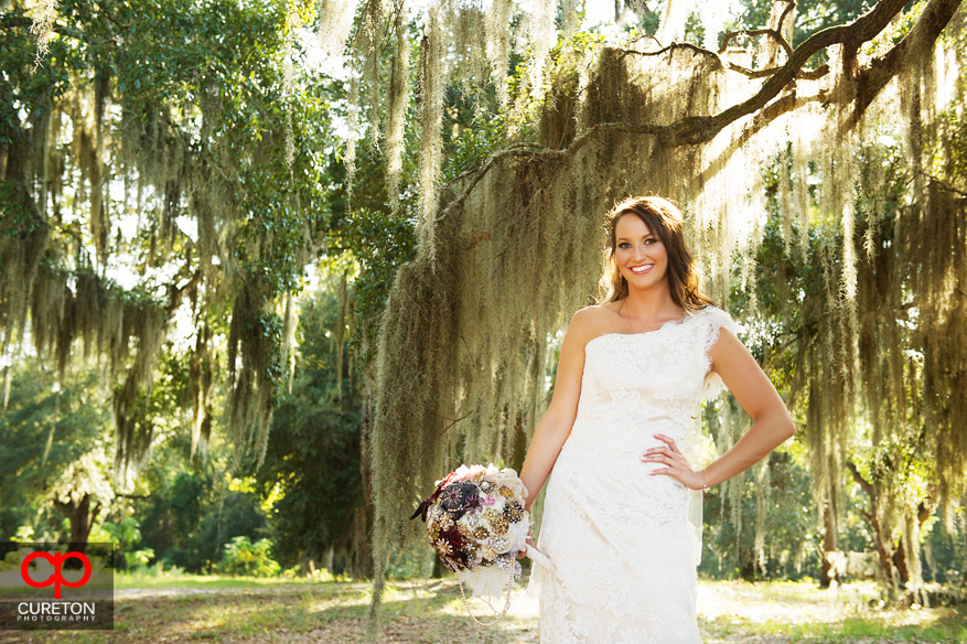 Bride with Spanish Moss trees in the background.