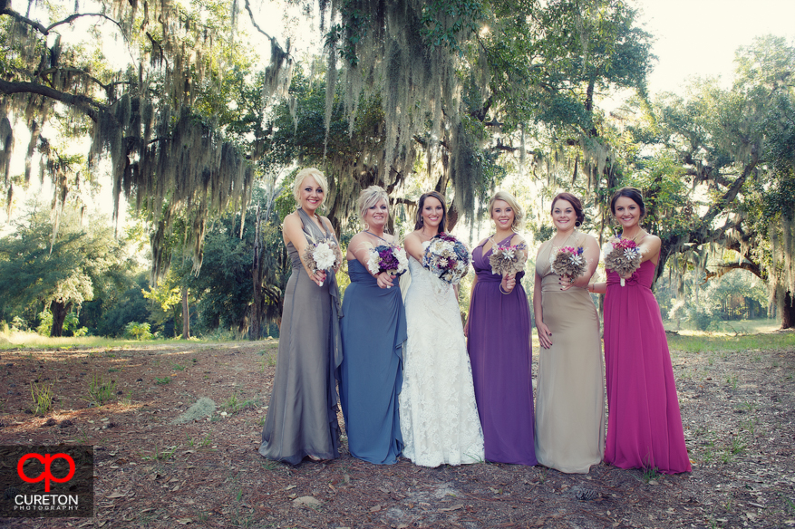 Bridesmaids standing in front of Spanish Moss.