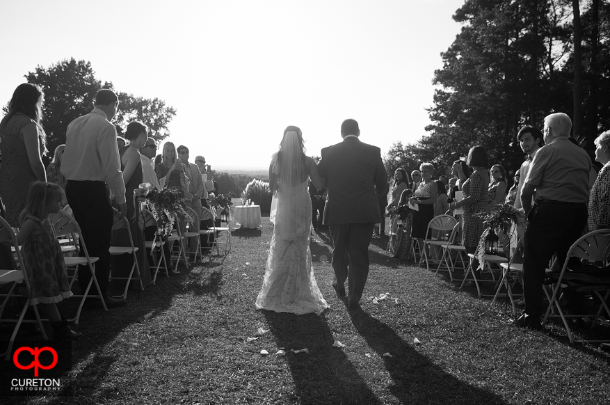 Father and Bride walk down the aisle at San Souci Farms in Sumter,SC.