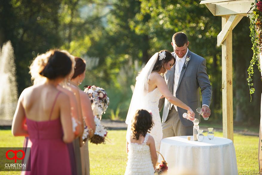 Bride and Groom do sand ceremony.