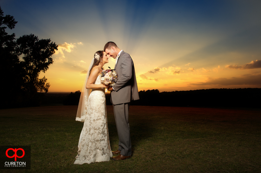 Bride and Groom touching foreheads at San Souci Farms.