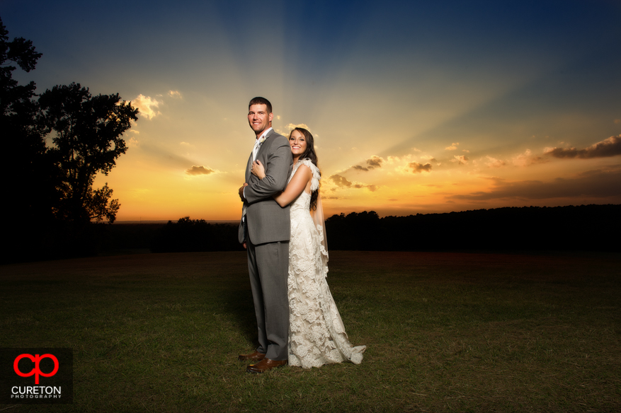 Bride and Groom at Sunset after their wedding at San Souci Farms in Sumter,SC.