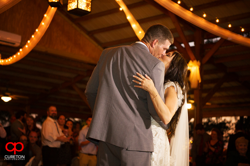 Bride and Groom kissing after their first dance at San Souci Farms in Sumter,SC.