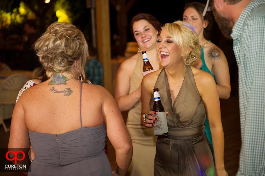 Bridesmaids having fun on the dance floor .