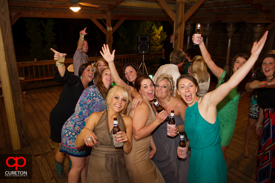 Wedding guests dancing looking at the camera.