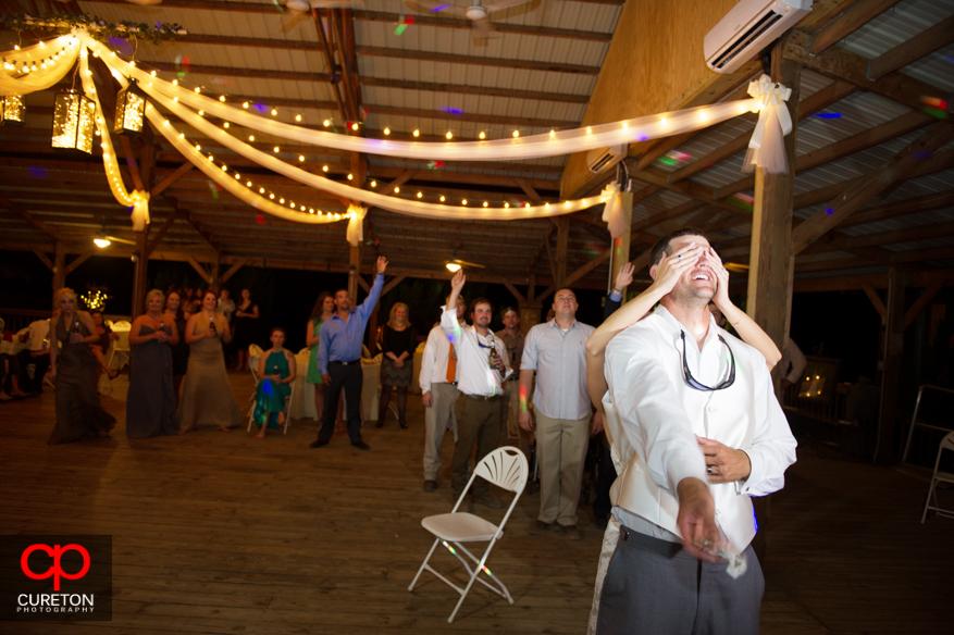 Groom throwing the garter.