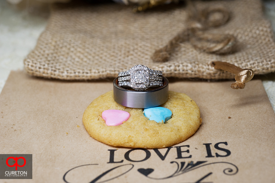 Wedding rings on a cookie.