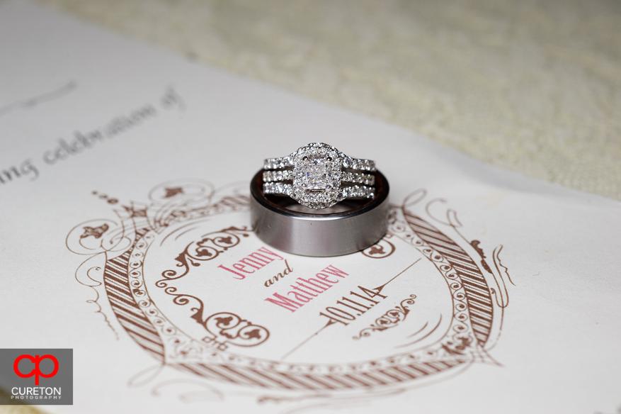 Wedding rings on the invitation.