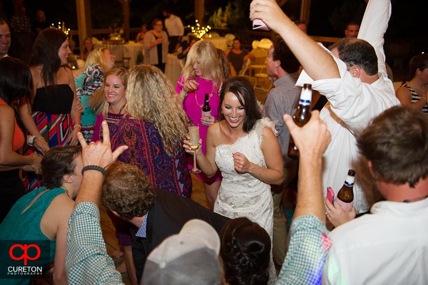 Bride dancing at her wedding reception.