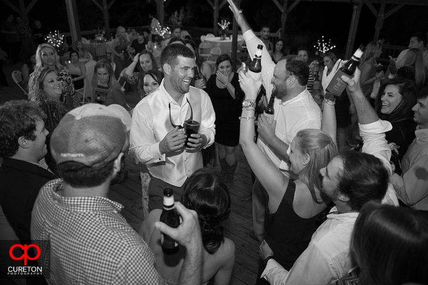 Groom dancing having at his reception.