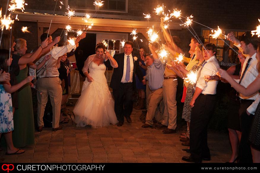 Bride and Groom leaving their wedding in Long Creek,SC lit by sparklers.