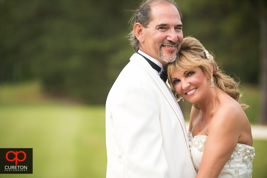 Bride and Groom hugging after their Spartanburg Country Club wedding.