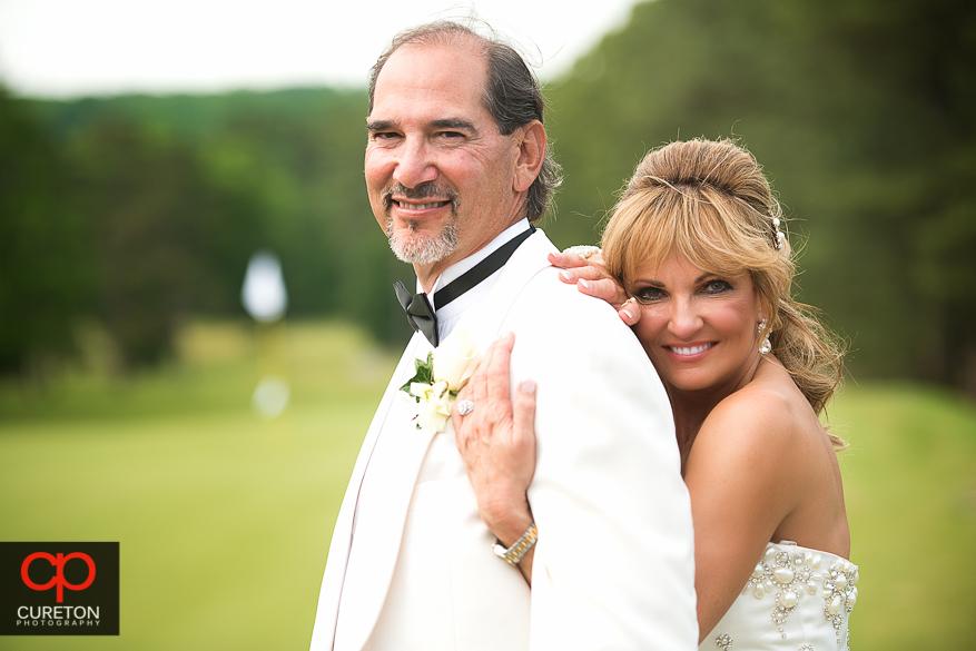 Couple posing their Spartanburg Country Club wedding.