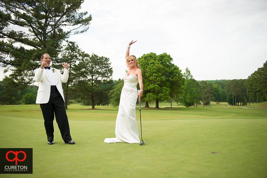 Bride sinks a putt on her wedding day.